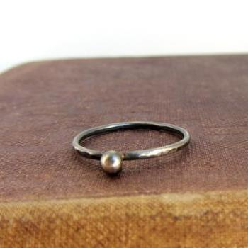 Oxidized sterling silver simple ball stack ring, hammered texture.