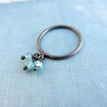 Oxidized sterling silver charm ring with blue aquamarine gemstones.